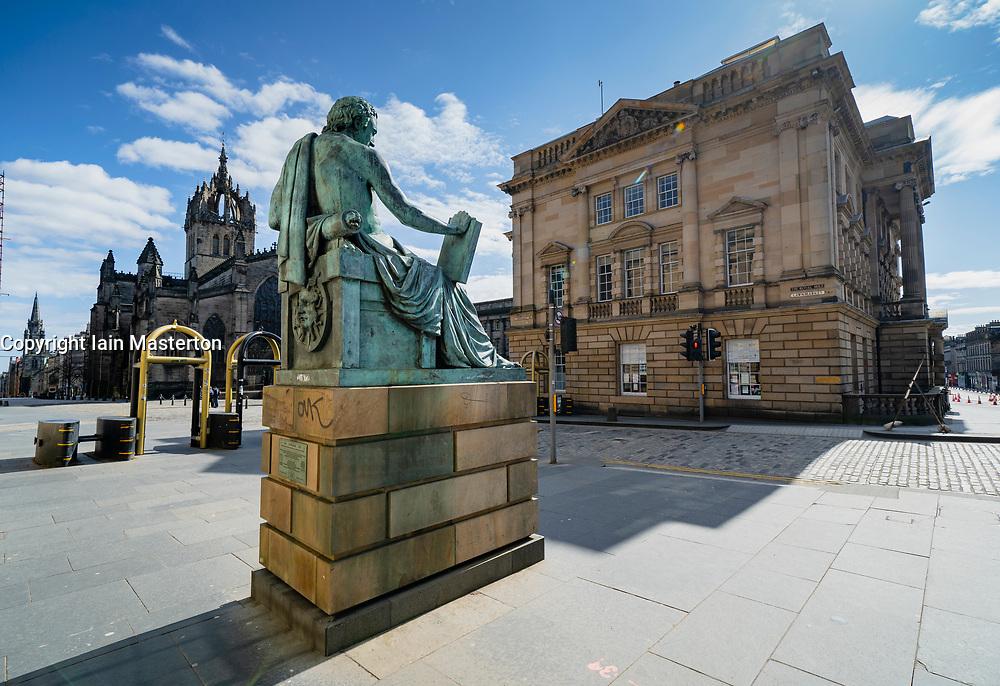 Empty Royal Mile at David Hume Statue during coronavirus pandemic and lockdown, in Edinburgh, Scotland, UK