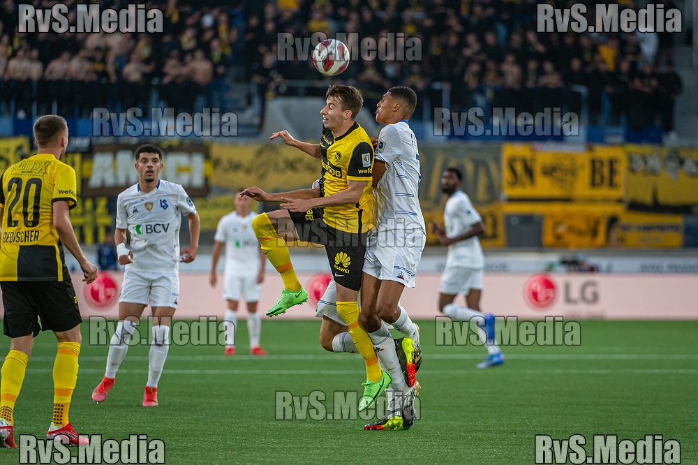 LAUSANNE, SWITZERLAND - SEPTEMBER 22: Sandro Lauper #30 of BSC Young Boys competes for header with Abdou Karim Sow #71 of FC Lausanne-Sport during the Swiss Super League match between FC Lausanne-Sport and BSC Young Boys at Stade de la Tuiliere on September 22, 2021 in Lausanne, Switzerland. (Photo by Monika Majer/RvS.Media)