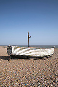 Ancient wooden boat on the beach between Aldeburgh and Thorpeness in Suffolk, England, UK