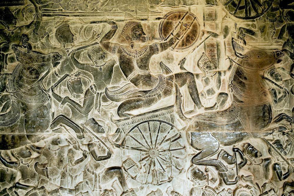 Angkor Wat : carved wall reliefs. West gallery, battle of Kurukshetra between Kauravas and Pandavas. Detail of leader in chariot