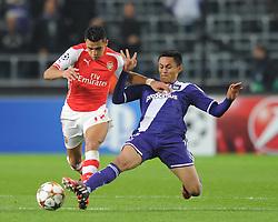 Arsenal's Alexis Sanchez is tackled - Photo mandatory by-line: Dougie Allward/JMP - Mobile: 07966 386802 - 22/10/2014 - SPORT - Football - Anderlecht - Constant Vanden Stockstadion - R.S.C. Anderlecht v Arsenal - UEFA Champions League - Group D