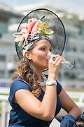 © Licensed to London News Pictures. 06/06/2014. Epsom, UK. Rachel Hanson 27, from Epsom, wears her self made hat which took her three days to complete.   Ladies Day today 6th June 2012 at Epsom 2014 Investic Derby Festival in Surrey. Traditionally, elegant, fashionable racegoers gather for a classic day's racing at Epsom Racecourse, Surrey. Photo credit : Stephen Simpson/LNP