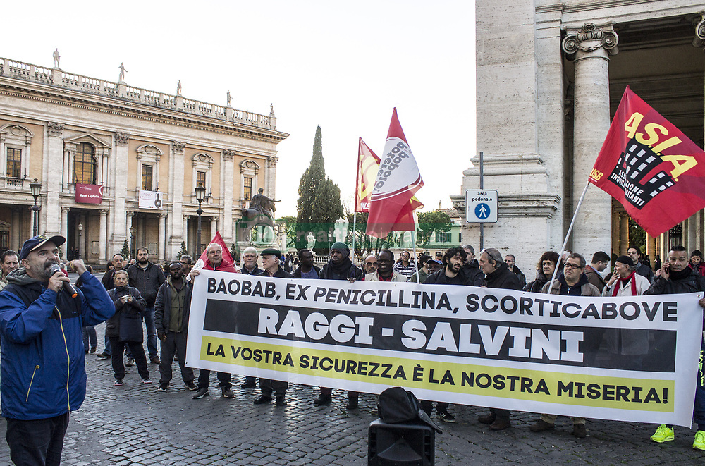 November 22, 2018 - Rome, Italy - Dozens of people have demonstrated at the Campidoglio against the security decree approved by Salvini and Di Maio. Municipalities can in fact vote for a motion that stops the application of the decree. At the moment, the Municipality of Rome has not expressed itself in this regard..The security decree primarily affects migrants, who will have less chance of being regular. The situation of irregularities in which they are placed by the State favors exploitation at work and the corporal. (Credit Image: © Elisa Bianchini/Pacific Press via ZUMA Wire)