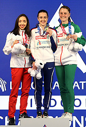 Great Britain's Laura Muir (centre), Poland's Sofia Ennaoui (left) and Ireland's Ciara Mageean with their medals at the Women's 1500m Final during day three of the European Indoor Athletics Championships at the Emirates Arena, Glasgow.