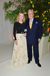 DAVID McDONOUGH and LADY MARY-GAYE CURZON at a dinner hosted by Cartier in celebration of The Chelsea Flower Show held at The Hurlingham Club, London on 19th May 2014.