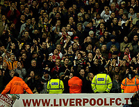 Photo: Paul Greenwood.<br />Liverpool v Arsenal. The FA Cup. 06/01/2007. Arsenal fans celebrate infront of the Liverpool hoardings