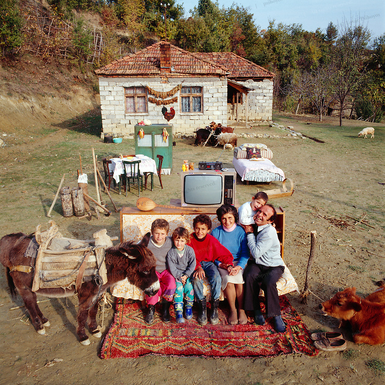 All the material posessions of the Cakoni Family in Albania, photographed outside their home in Bei Burrel.  Left to Right Hajdar C. right, wife Hanke, Armond, Ardian, Artila and Aurel with father.