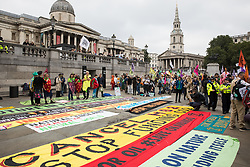 London, UK. 4th September, 2021. Extinction Rebellion climate activists assemble in Trafalgar Square to take part in a colourful March for Nature on the final day of their two-week Impossible Rebellion. Extinction Rebellion are calling on the UK government to cease all new fossil fuel investment with immediate effect.