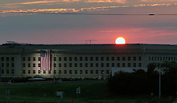 September 11, 2016 - Arlington, United States of America - The sunrises over the Pentagon where a flag is draped in remembrance of those killed in the 9/11 terrorist attacks on the 15th anniversary September 11, 2016 in Arlington, Virginia. (Credit Image: © Damon J. Moritz/Planet Pix via ZUMA Wire)