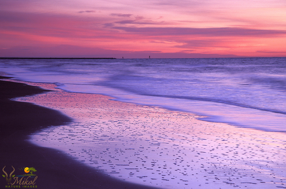 Sunrise over Atlantic with pastel colors and Jetty Navigation markers, Huntington Beach State Park, SC