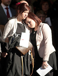© under licence to London News Pictures. The funeral took place earlier today of Pte Conrad Lewis 4 PARA, at St Mary`s Church, Warwick. Pte Lewis died from gun shot wounds received whilst on patrol in Helmand province on 9 February 2011. Pictured, girlfriend Georgina Harris, left and sister Siobhan after the service..Picture credit: Dave Warren/London News Pictures...