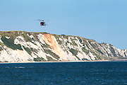HM Coastguard rescue helicopter (G-C1JW) flying along the white cliffs between Dover and Folkestone. Folkestone Harbour, Folkestone, Kent. UK. 6th August 2016. (photo by Andrew Aitchison / In pictures via Getty Images)