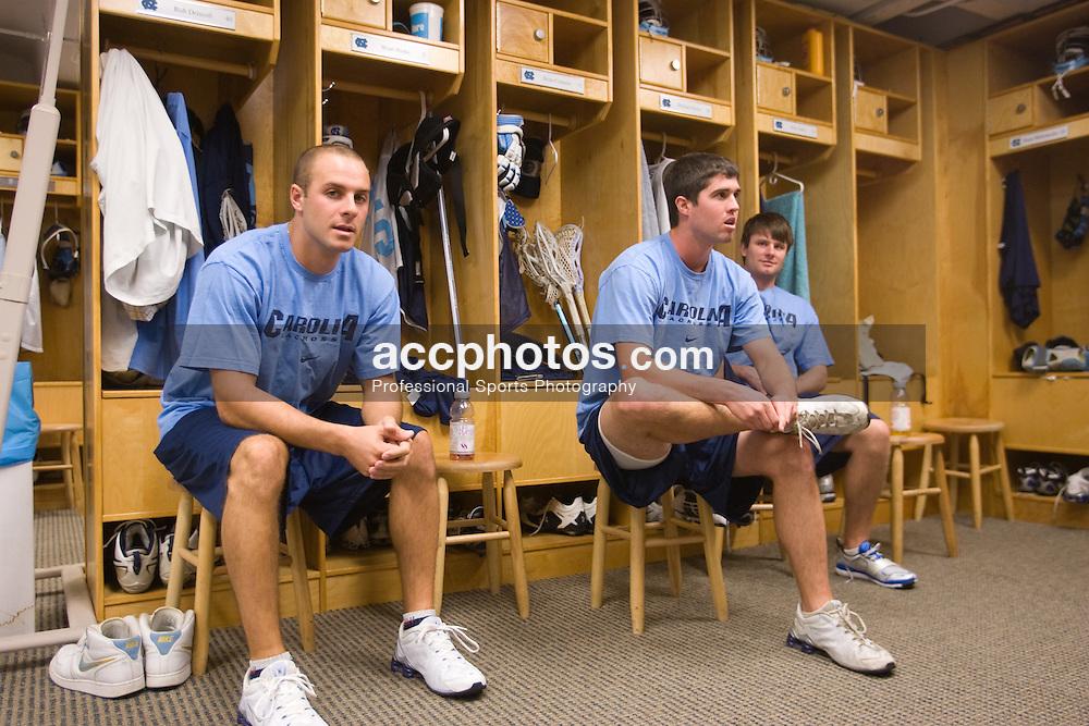 05 October 2007: North Carolina Tar Heels men's lacrosse members Rob Driscoll, Brian Connors and Michael Burns in the locker room in Chapel Hill, NC.
