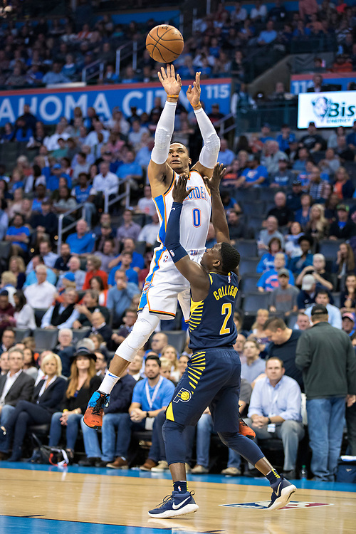 OKLAHOMA CITY, OK - OCTOBER 25:  Russell Westbrook #0 of the Oklahoma City Thunder shoots a jump shot over Darren Collison #2 of the Indiana Pacers at the Chesapeake Energy Arena on October 25, 2017 in Oklahoma City, Oklahoma.  NOTE TO USER: User expressly acknowledges and agrees that, by downloading and or using this photograph, User is consenting to the terms and conditions of the Getty Images License Agreement.  The Thunder defeated the Pacers 114-96.  (Photo by Wesley Hitt/Getty Images) *** Local Caption *** Russell Westbrook; Darren Collison