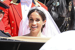 The Duke and Duchess of Sussex leave St Georges Chapel in Windsor on the Carriage ride after their wedding<br /><br />19 May 2018.<br /><br />Please byline: Vantagenews.com