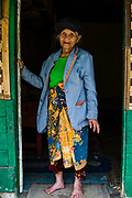 A local woman poses at here house located in Parahyangan, a remote area in the highlands of West Java.