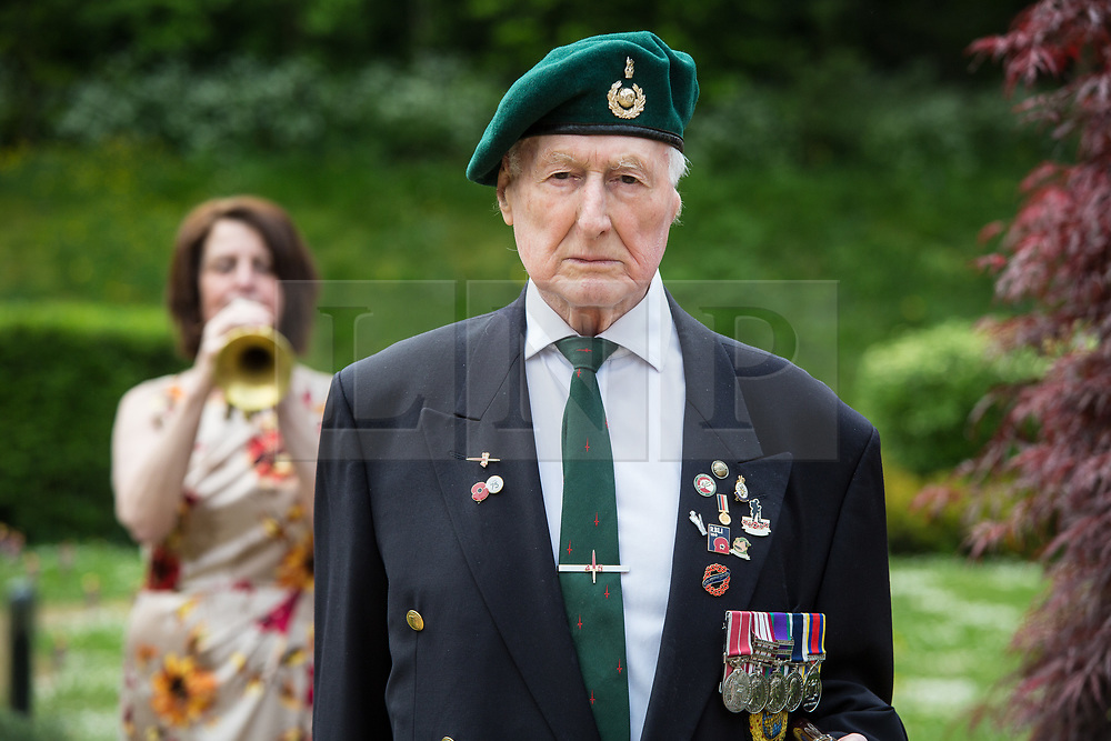 @Licensed to London News Pictures 08/05/2020. Maidstone, UK.. RBLI bugler Elaine Williams plays the Retreat Call as WO George Bradford BEM Royal Marine Commando, 40 Commando pays tribute to VE75 Day at Queen Elizabeth Court in the Royal British Legion village in Aylesford, Kent. RBLI also wanted to use Two Minute Silence to honour the service and sacrifice of the Second World War generation and reflect on the devastating impact Covid-19 has had on so many lives across the world.  Photo credit: Manu Palomeque/LNP