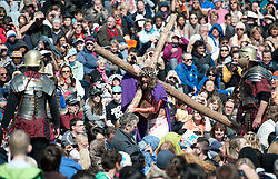 © London News Pictures. 06/04/2012. London, UK.  An actor playing Jesus carrying the cross through crowds of spectators during a performance of  The Passion of Jesus  in front of thousands of people in Trafalgar Square in central London, England on  April 6, 2012  to mark Good Friday. The actors come from the Wintershall Estate in Surrey. Photo credit :  Ben Cawthra/LNP