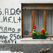 LONGARONE, ITALY - SEPTEMBER 26:  A sign against ENEL and SADE considered the responsible of the Vajont tragedy is seen on  September 26, 2013 in Longarone, Italy. The Vajont  tragedy happened on the night of the 9th October 1963, when a landslide broke away from Mount Toc and fell into the Vajont river causing a wave that struck the neighboring towns, the devastation was total, more than 2000 people died and only few lucky villagers survived.  (Photo by Marco Secchi/Getty Images)
