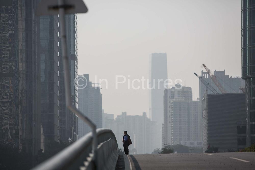 A man walks over a road bridge in Shenzhen, China, on Wednesday, Dec. 16, 2015.