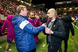 Bristol City Assistant Head Coach Dean Holden congratulates Manchester City manager Pep Guardiola after Manchester City win 2-3 - Rogan/JMP - 23/01/2018 - Ashton Gate Stadium - Bristol, England - Bristol City v Manchester City - Carabao Cup Semi Final Second Leg.
