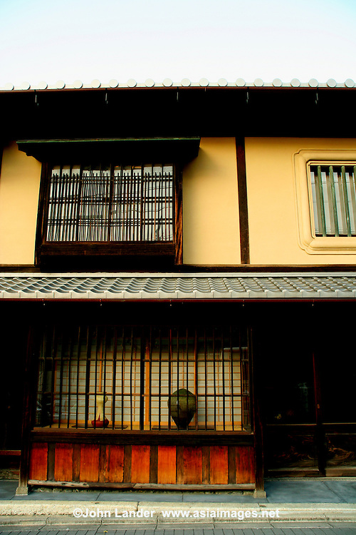 Machiya Architecture in Kyoto - Machiya  are traditional wooden townhouses typified in the historical capital of Kyoto. Machiya housed urban merchants and craftsmen.  Machiya in Kyoto  defined the architectural atmosphere of downtown Kyoto for centuries and represent the standard defining form of machiya throughout Japan.  The typical Kyoto machiya is a long wooden home with narrow street frontage, stretching deep into the city block and often containing one or more small courtyard gardens