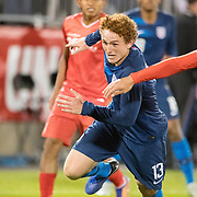 EAST HARTFORD, CONNECTICUT- October 16th: Josh Sargent #13 of the United States defended by Alexander Callens #5 of Peru during the United States Vs Peru International Friendly soccer match at Pratt & Whitney Stadium, Rentschler Field on October 16th 2018 in East Hartford, Connecticut. (Photo by Tim Clayton/Corbis via Getty Images)