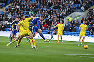 Anthony Pilkington of Cardiff city © shoots and he scores his teams 1st goal. Skybet football league championship match, Cardiff city v Rotherham Utd at the Cardiff city stadium in Cardiff, South Wales on  Saturday 23rd January 2016.<br /> pic by  Andrew Orchard, Andrew Orchard sports photography.