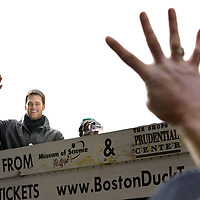 """(02/08/2005-Boston, MA) """"GO FOR # FOUR""""Patriot's Superbowl Victory Parade........A fan yells to """"go for # 4"""" as Tom Brady acknowledges him. Photo: Mark Garfinkel."""