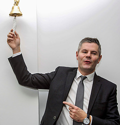"""Derek Mackay, Finance Secretary (left), rings the """"Success Bell"""" at the official opening of the building services firm's office at Ratho, Edinburgh. The bell is rung to mark achievements by the company and its employees. Pic: Terry Murden @edinburghelitemedia"""