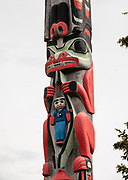 Totem pole outside of the Sheldon Museum and Cultural Center, Haines, Alaska, USA. This interesting museum showcases the art and culture of Haines, with over 4000 artifacts including Chilkat Blankets, Eldred Rock lighthouse lens, 12,000 cataloged photographs from the 1800s until today; books and countless documents. <br /> https://www.sheldonmuseum.org/