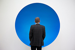 © Licensed to London News Pictures. 09/10/2012. LONDON, UK.  A gallery visitor views Anish Kapoor's sculpture 'Inner Beauty' (2012) at a press view ahead of his new exhibition at the Lisson Gallery in London today (09/12/12) . The exhibition, the first since the artists solo exhibition at the Royal Academy of the Arts in 2009, features new works by Kapoor and runs from the 10th of October to the 10th of November 2012. Photo credit: Matt Cetti-Roberts/LNP