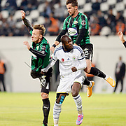 Akhisar Belediye Genclik Spor's Ahmet Cebe (L) and Fenerbahce's Moussa Sow (C) during their Turkish Super League soccer match Akhisar Belediye Genclik Spor between Fenerbahce at the 19 Mayis Stadium in Manisa Turkey on Sunday, 28 September 2014. Photo by TURKPIX