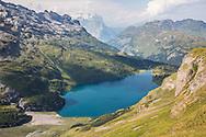 Mountain lake along the Via Alpina in the Swiss Alps
