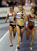 Carrie Tollefson leads Shayne Culpepper (left) and Sarah Schwald in the women's 3,000 meters in the USA Track & Field Indoor Championships at Reggie Lewis Track & Athletic Center at Roxbury Community College on Saturday, Feb. 28, 2004 in Roxbury Crossing, Mass.
