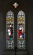 Stained glass window church of Saint Peter, Sibton, Suffolk, England, UK circa 1871 by Lavers, Barraud and Westlake scenes relating to missionary work