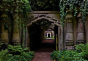 The Egyptian gateway, flanked by a pair of massive obelisks in Highgate Cemetery is the entrance to an avenue, lined with tombs, leading up to the Circle of Lebanon, 25th May, 2005, Highgate Cemetery, London, United Kingdom. When the cemetery was founded in the 1830s interest in ancient Egypt was still very strong, encouraged by Napoleons campaigns.