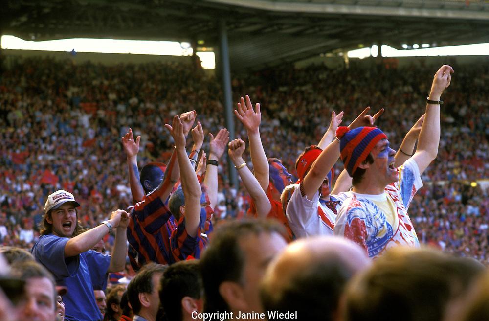 Crystal Palace football fans at match at Wembley Stadium.