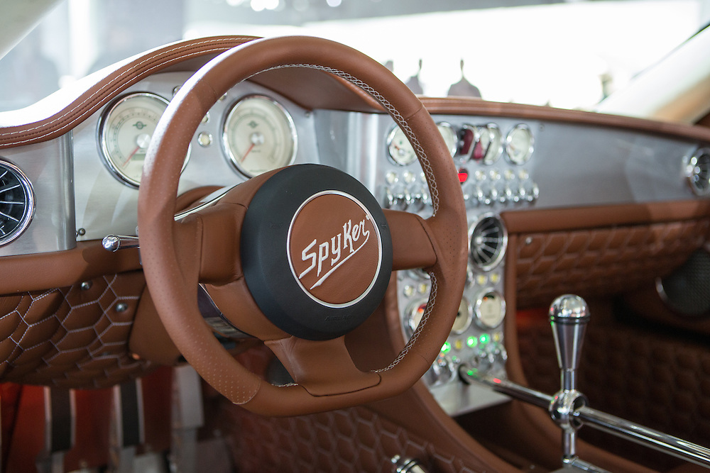 New York, NY, USA-23 March 2016. The cockpit  of the Spyker C8 Preliator, a Dutch-built sportscar with an Audi V8 engine.This model has a 6-speed Getrag manual transmission, with open transmission linkage as an interior design feature. The tachometer goes to 8,000RPM, the speedometer to 220mph.