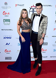 Abigail Clarke (left) and Junaid Ahmed attending the 8th Annual Asian Awards held at the Hilton Hotel, Park Lane, London.