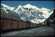 Freight cars in RGS Telluride yard with water tank to right in background as viewed from the depot.<br /> RGS  Telluride, CO  Taken by August, Irving - 4/15/1949<br /> Thanks to Don Bergman for additional information.
