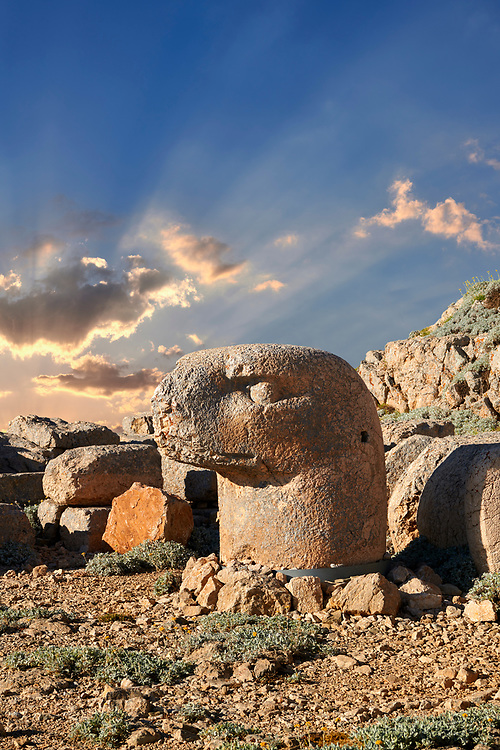 Statue head at sunrise of an Eagle in front of the stone pyramid 62 BC Royal Tomb of King Antiochus I Theos of Commagene, east Terrace, Mount Nemrut or Nemrud Dagi summit, near Adıyaman, Turkey .<br /> <br /> If you prefer to buy from our ALAMY PHOTO LIBRARY  Collection visit : https://www.alamy.com/portfolio/paul-williams-funkystock/nemrutdagiancientstatues-turkey.html<br /> <br /> Visit our CLASSICAL WORLD HISTORIC SITES PHOTO COLLECTIONS for more photos to download or buy as wall art prints https://funkystock.photoshelter.com/gallery-collection/Classical-Era-Historic-Sites-Archaeological-Sites-Pictures-Images/C0000g4bSGiDL9rw