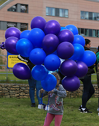 People gather to release balloons outside Alder Hey Children's Hospital in Liverpool, following the death on Saturday morning of 23-month-old Alfie Evans, who was being treated at the hospital.
