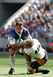 Frikkie Walsh tackled by Dean Grant during the Festival of Rugby match between The Boland Cavaliers and The Stormers held at The Cape Town Stadium (formerly Green Point Stadium) in Cape Town, South Africa on 6 February 2010.  This is the first match/event to be held at the new stadium which was purpose built to host matches during the FIFA World Cup South Africa 2010.Photo by: Ron Gaunt/SPORTZPICS