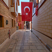 Big Turkey flag in Kaleici district narrow street in Antalya old town