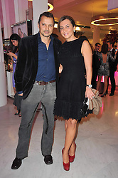 GERRY DEVEAUX and ELLA KRASNER at the launch of Project PEP to benefit the Elton John Aids Foundation hosted by Tamara Mellon and Diana Jenkins in association with Jimmy Choo held at Selfridges, Oxford Street, London on 29th October 2009.