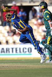 © Licensed to London News Pictures. 08/03/2012. Adelaide Oval, Australia. Lasith Malinga in his delivery stride while bowling during the One Day International cricket match final between Australia Vs Sri Lanka. Photo credit : Asanka Brendon Ratnayake/LNP
