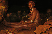A Hamar bride who following local traditions lives alone in the loft of her parents-in-law's home for three months before consummating the marriage, in South Omo, Ethiopia. She is covered from top to toe in red ochre and butter to ward off evil.  The 40,000-strong, cattle-herding Hamar are among the largest of the 20 or so ethnic groups which inhabit the culturally diverse South Omo region in south-west Ethiopia.