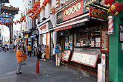 Chinatown remains very quiet with a few people visiting Chinese restaurants to pick up takeaway food and to see the red lanterns on 25th June 2020 in London, England, United Kingdom. As the July deadline approaces and government will relax its lockdown rules further, the West End remains quiet, while some non-essential shops are allowed to open with individual shops setting up social distancing systems.