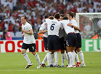 Photo: Chris Ratcliffe.<br /> England v Ecuador. 2nd Round, FIFA World Cup 2006. 25/06/2006.<br /> David Beckham of England celebrates scoring the first goal as Wayne Rooney is all smiles.